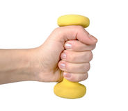 Hand holding yellow dumbbell. On a white background royalty free stock photo