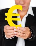 Hand Holding Yellow Euro Sign In Hand Royalty Free Stock Photo