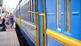 Hand holding a yellow flag sign of readiness for dispatch. Train Station, Belaya Tserkov, Ukraine - July 29, 2015.Hand holding a yellow flag sign of readiness stock footage