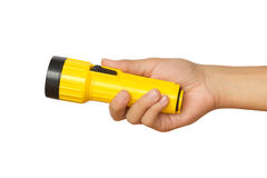 Hand holding yellow flashlight over white background Stock Photos