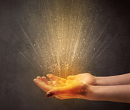 Hand holding yellow light Stock Images