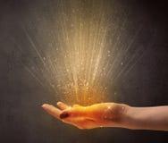 Hand holding yellow light Stock Photos