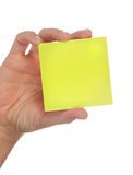 Hand holding a yellow note Stock Photography