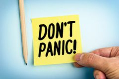 Hand Holding Paper Note With Words Don`t Panic. Hand Holding Yellow Paper Note With Words Don`t Panic Royalty Free Stock Images