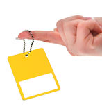 Hand holding yellow price tag Stock Photos