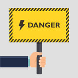 Hand holding yellow stop danger sign. Flat style design. Vector illustration. Stock Photos