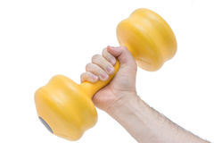 Hand holding yellow weights Stock Photo