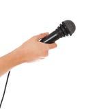 hand holdingmikrofonen Arkivfoton