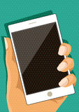 Hand holdng white smartphone, with blank screen. Pop art comic style. Vector illustration Royalty Free Stock Images