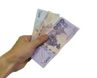 Hand Holdnig Money. A hand holding money isolated Money Thailand on white background Royalty Free Stock Photo