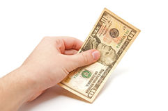 Hand holds a 10 dollar bill Stock Image
