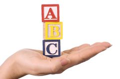 Hand Holds A Cube With Letters Royalty Free Stock Photography