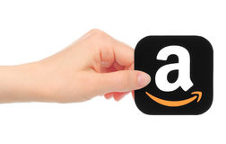 Hand holds Amazon icon royalty free stock photo