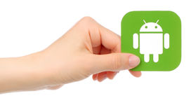 Hand holds Android icon Royalty Free Stock Photography