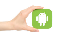 Hand holds Android logo. Kiev, Ukraine - May 18, 2016: Hand holds Android logo printed on paper on white background stock images