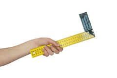 Hand holds the angular ruler Stock Photography