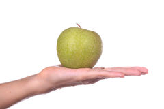 Hand holds the apple Royalty Free Stock Photo