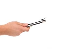 Hand holds apple corer. Stock Image
