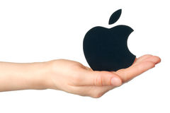 Hand holds apple logotype printed on paper on white background Royalty Free Stock Photo