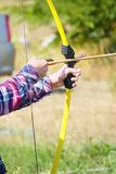 Hand holds archery and arrow stock photography