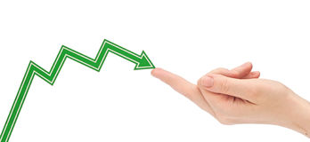 Hand holds the arrow graph. On a white background Royalty Free Stock Image