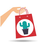 Hand holds bag gift cactus design Stock Image