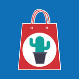 Hand holds bag gift cactus design Royalty Free Stock Images