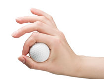 Hand holds a ball for golf Stock Photography