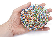 Hand holds ball from a  internet cable Royalty Free Stock Photos