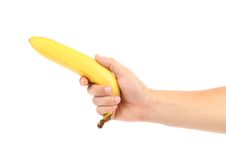 Hand holds banana Stock Images