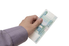 Hand holds a banknote of 1000 rubles Stock Images