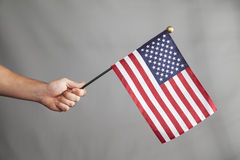 Hand Holds Big Flag Royalty Free Stock Photos