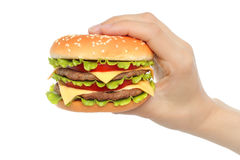 Hand holds big hamburger Stock Photos