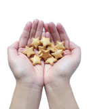 Hand holds biscuits. Hand holds Five-pointed shaped star biscuits stock image