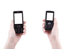 Hand holds black cell phone. Isolated on a white background Royalty Free Stock Image