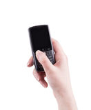 Hand holds black cell phone. Stock Image