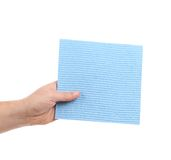 Hand holds blue cleaning sponge. Royalty Free Stock Photos