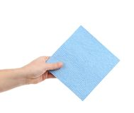 Hand holds blue cleaning sponge. Royalty Free Stock Photography