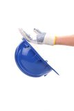 Hand holds blue hard hat. Royalty Free Stock Photo