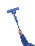 Hand holds blue mop with sponge. Royalty Free Stock Photo