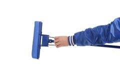 Hand holds blue mop with sponge. Stock Images