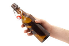 Hand holds a bottle of beer. Royalty Free Stock Photos