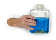 Hand holds bottle of flammable blue liquid Royalty Free Stock Photography