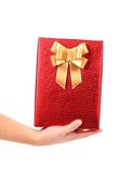 Hand holds box with bow studded asterisks. Royalty Free Stock Images