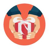 The hand that holds the box, gift. Flat style Royalty Free Stock Photography