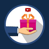 The hand that holds the box, gift, transfers it to another Royalty Free Stock Image