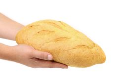 Hand holds bread of corn meal. Royalty Free Stock Photography
