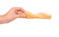 Hand holds bread with sesame. Royalty Free Stock Photo