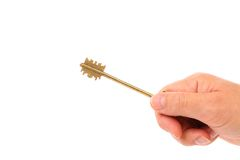 Hand holds bronze steel key. Royalty Free Stock Image
