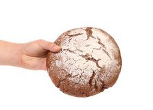 Hand holds brown round bread. Royalty Free Stock Photos